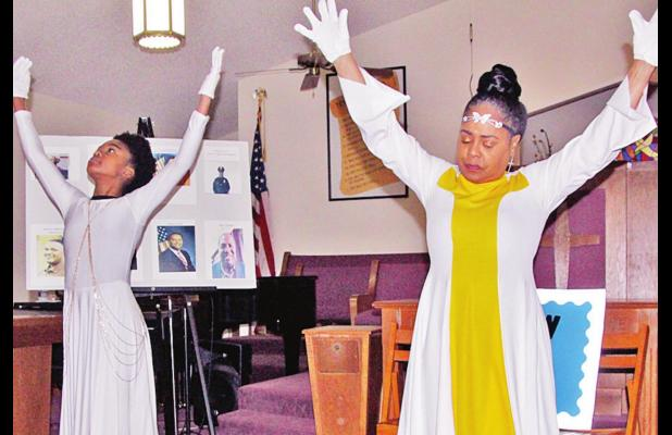 Praise dancers Angela McDonald, at right, and her granddaughter, A'Shaiya Jones, 13, perform at the League of Involved Women at Sunday's Black History program. The event was held at Sweet Home Baptist Church, and behind the two can be seen one of two