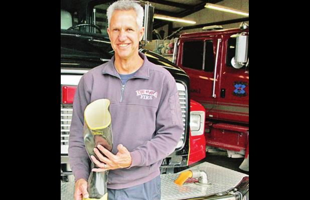 Bryan Cruze will be one of several Mexia Fire Department firefighters holding a boot on Milam Street in Mexia next week to collect donations to benefit the Muscular Dystrophy Association. See times and locations in the accompanying article. Photo by Roxan