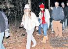 The adventurers on the Midnight Hike at Fort Parker State Park return from their half-mile walk in the pitch blackness late on Dec. 31. The event would continue with a scavenger hunt, refreshments and a countdown to midnight. Photo by Roxanne Thompson/The